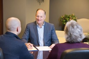 Albert Schlotfeldt conferring business formation with potential clients